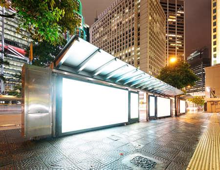 Blank billboard on bus stop at night  Stock fotó