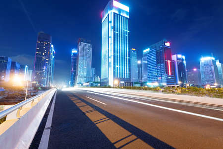 city  buildings: light trails on the street at dusk in guangdong,China