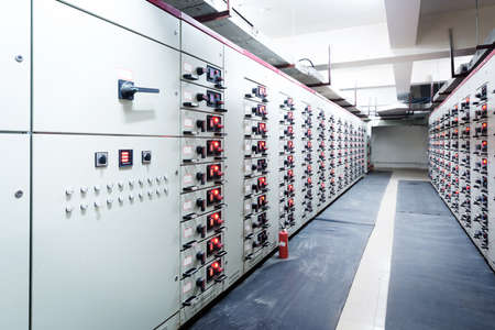 power distribution: Electrical energy distribution substation in a power plant. Stock Photo