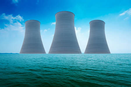 Nuclear power plant on the coast. Ecology disaster concept. photo