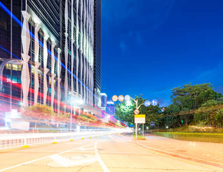 light trails on the street at dusk in guangdong,China photo