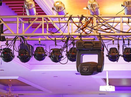 Studio lighting equipment high above an outdoor theatrical performance. photo