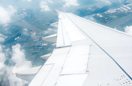 Wing aircraft in altitude during flight photo