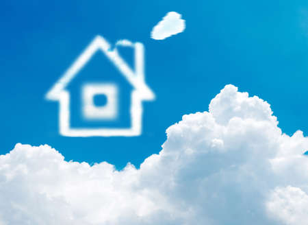 House of clouds in the blue sky on gradient-white background photo