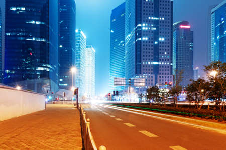 dark street: the light trails on the modern building background in shanghai china
