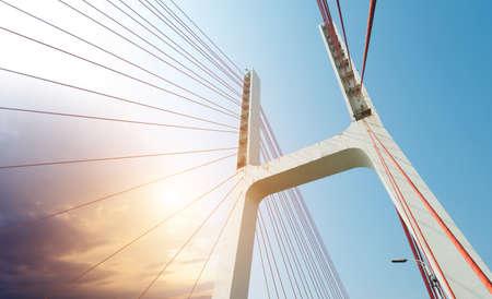 highroad: Modern bridge cables, twilight landscape.