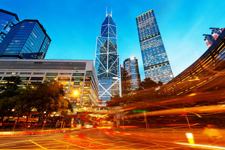traffic building: the light trails on the modern building background in shanghai china. Stock Photo