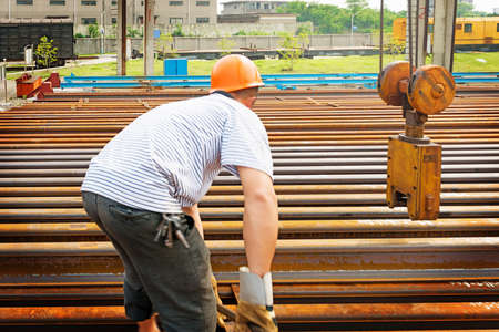 capping: worker working in Steel pipes on the rack