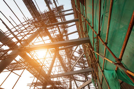 Silhouettes of scaffolding on sunset photo