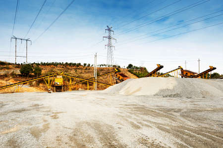 gravel pit: Open pit mining and processing plant for crushed stone, sand and gravel to be used in the roads and construction industry Stock Photo
