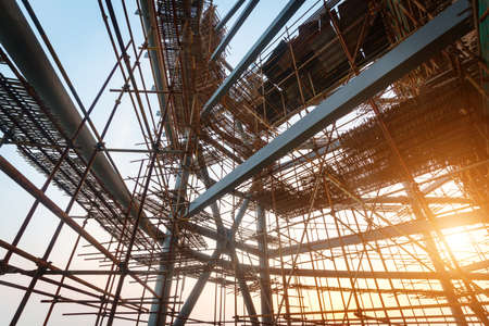 Silhouettes of scaffolding on sunset