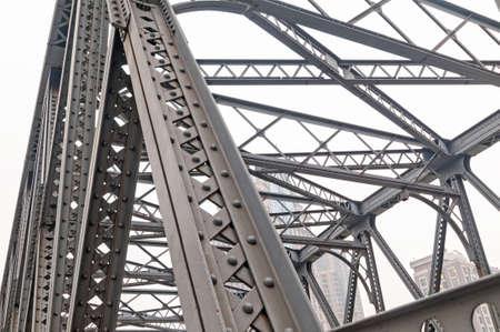 Support above the bridge, steel structure close-up. 版權商用圖片