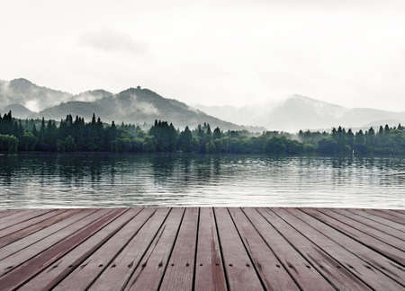 Mountains, lakes and the early morning fog Stock fotó