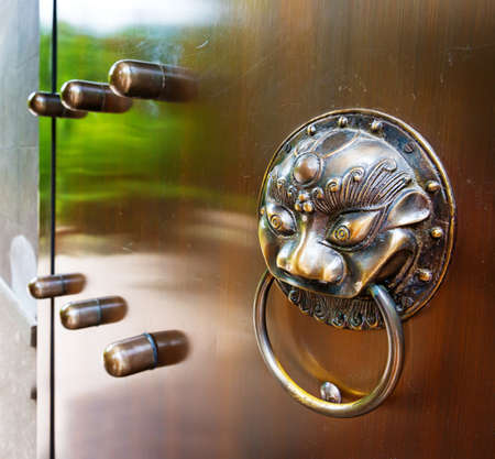 intermediate: Chinese classical architecture knocker, animal statues with intermediate colors. Stock Photo