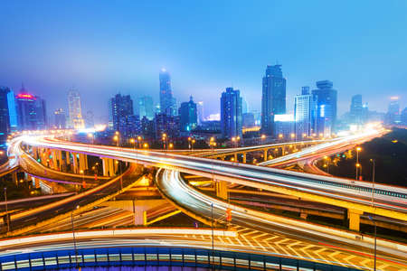 urban transport: shanghai interchange overpass and elevated road in nightfall Stock Photo