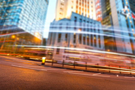 the light trails on the modern building background in shanghai china. Foto de archivo