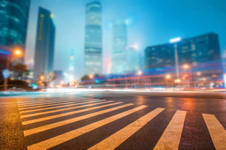 urban landscapes: the light trails on the modern building background in shanghai china. Stock Photo