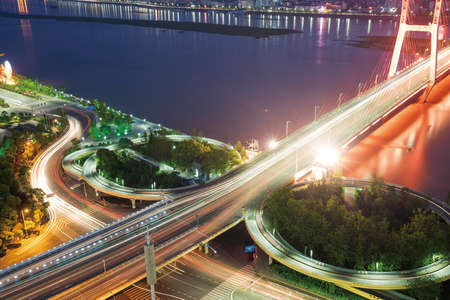 highroad: Asias largest across the rivers in Shanghai landmarks a spiral bridge at night