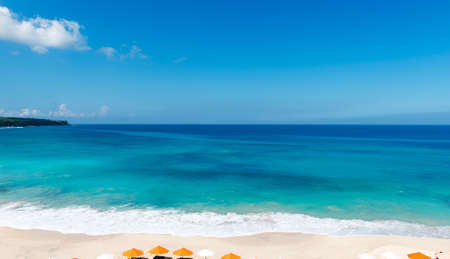 idling: Beach chairs on the white sand beach with cloudy blue sky Stock Photo