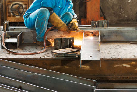 Worker welding the steel structure