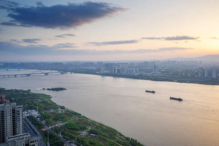 Aerial view of city buildings and river, China Nanchang.
