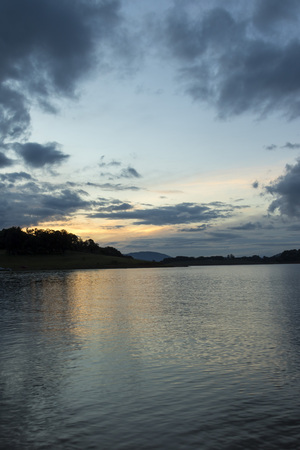 late afternoon sunset on a lake in the countryside of sao paulo - wide angle vertical