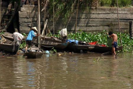 mekong: Vietnamese working in the Mekong River in southern Vietnam