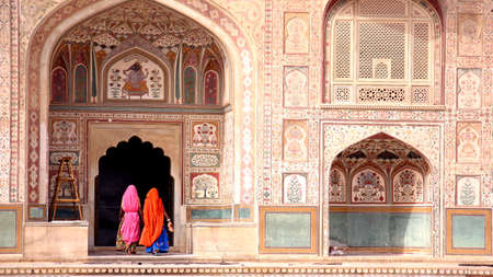 Two women walking in the Amber Fort, Jaipur photo