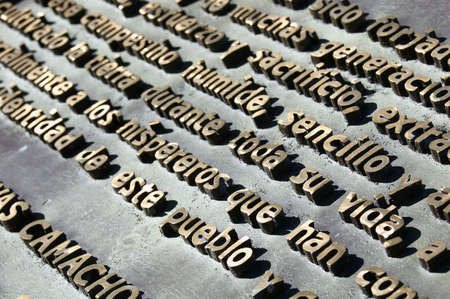 Photograph of a text with embossed metal letters photo