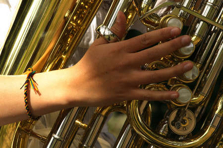 tuba: Girl hand playing a tuba