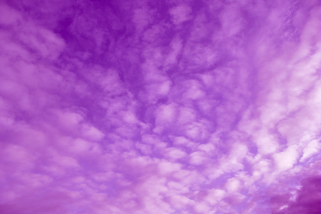Colorized sky with soft violet clouds Stock Photo