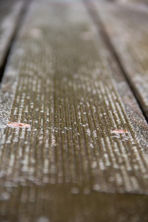 One wooden floor board with two rusty screws Foto de archivo