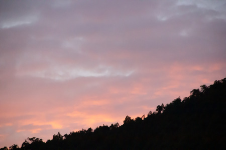 Dramatic sunset with soft clouds in orange, pink and blue tones