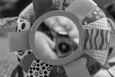 Baby toy in black and white with a mirror on low position
