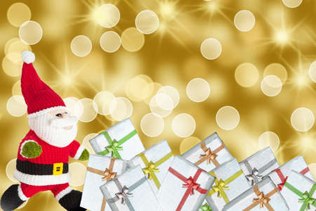 Chinese Santa Claus with gift boxes with golden shiny background