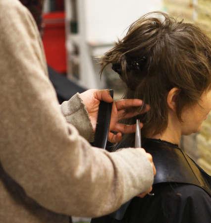 gripping hair: Hairdresser working
