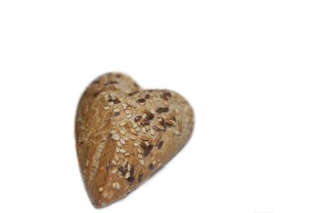 Brood met zaaigranen in hartvorm Stockfoto