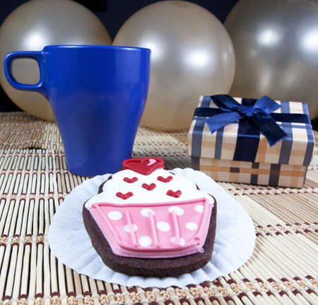 Sweet cup cake cooky, gift box, cup of coffee and balloons   Stock Photo