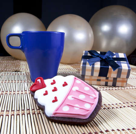 cooky: Sweet cup cake cooky, gift box, cup of coffee and balloons   Stock Photo