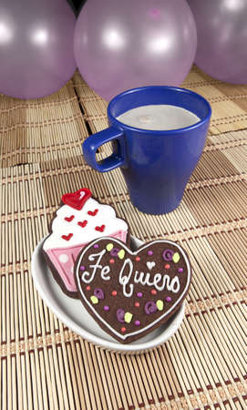 cooky: Sweet cooky with spanish love text  Te quiero  other cup cake cooky, cup of coffee and balloons