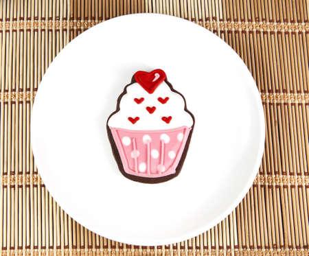 Dolce cup cake cooky sul piatto bianco Archivio Fotografico