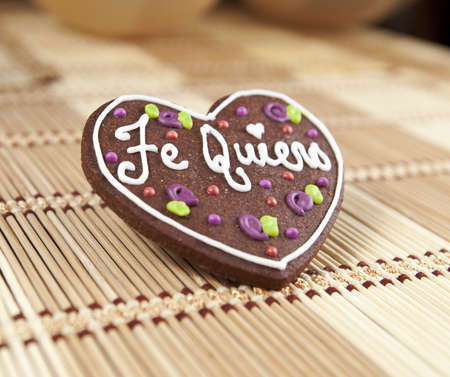 Sweet heart cooky with spanish text love you  Te quiero Stock Photo - 18380244