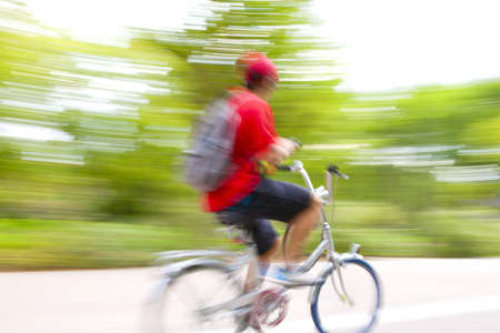 Riding bike on morning light through the park Stock Photo