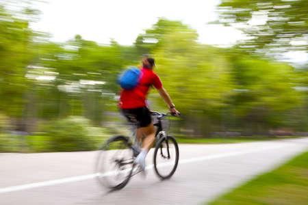 Riding bike on morning light through the park Stockfoto