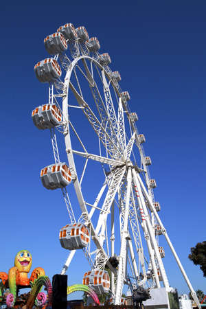 midway: Summer day in circus, ferris wheel Stock Photo