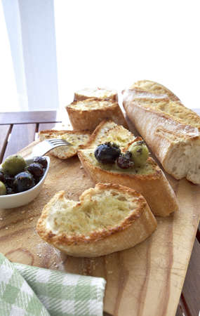 Close up of bread with olives  photo