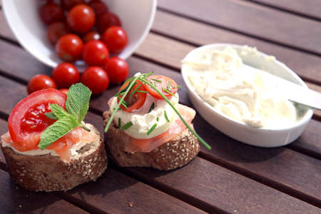 Close up of bread with slamon, tomatos and cheese