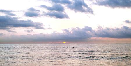 Swimming at colorful Sunrise in Mediterranean sea Stock Photo
