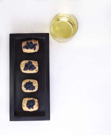 Caviar and salmon canape with copy space Stock Photo