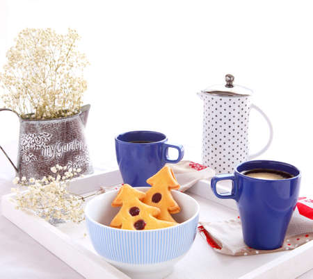 Candid breakfast with sweet pastries with a shape of a tree